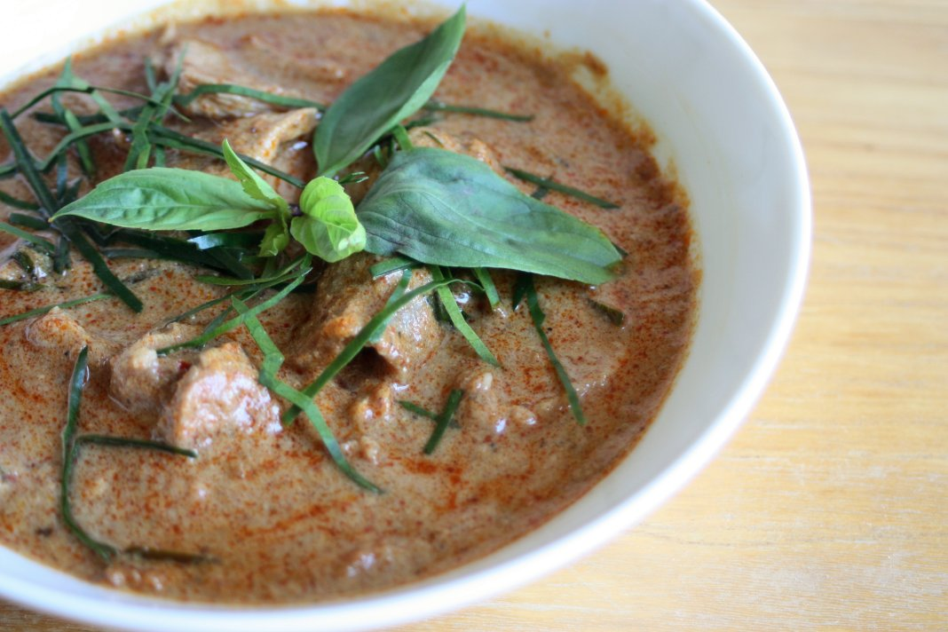 With pork tenderloin and Thai sweet basil. Italian sweet basil is also a very good. The combination of kaffir lime  and basil leaves is so delicious, though they both have to be fresh; otherwise, just do without. Far preferable to attempting to use dried stuff in this particular dish.