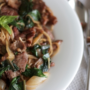 Spicy Thai-style fried noodles with pork and sweet basil