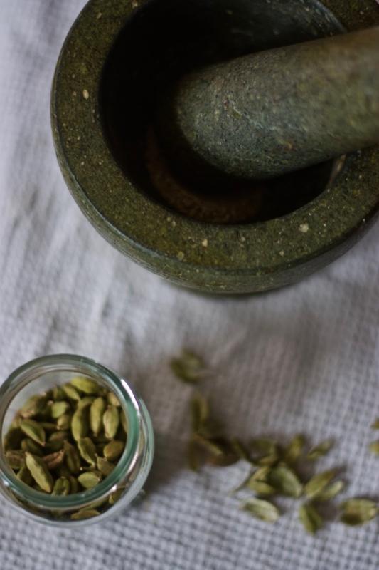 Cardamom in pestle and mortar