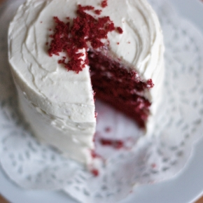 Small red velvet cake with cream cheese white chocolate frosting